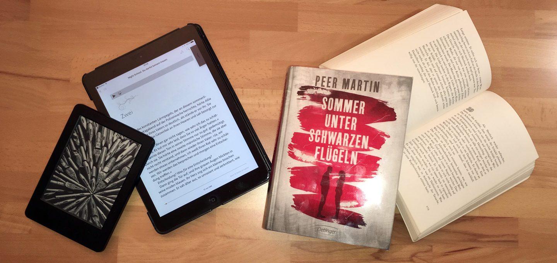 eBook Reader neben Büchern